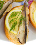 Sandwich with sprats. Close-up sandwich with sprats, isolated on white Royalty Free Stock Image