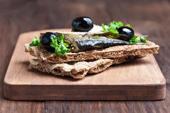 Sandwich with sprats and olives Stock Images