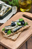 Sandwich with sprats and olives Stock Image