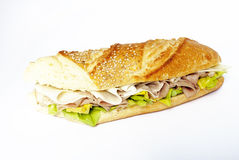 Sandwich. A sandwich stuffed with lettuce, ham and cheese Royalty Free Stock Images