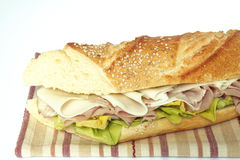 Sandwich. A sandwich stuffed with lettuce, ham and cheese Royalty Free Stock Photos