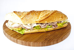 Sandwich. A sandwich stuffed with lettuce, ham and cheese Royalty Free Stock Photography