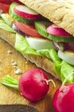 Sandwich sur le panneau de pain Photographie stock