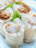 Sandwich sushi rolls. Salad tuna, ham cheese and dried shredded pork on dish Stock Image