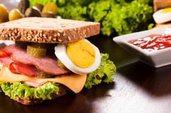 Sandwich on the table. Big and tasty sandwich on the wooden table Royalty Free Stock Images