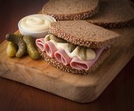 Sandwich. Tasty and fresh mortadella sandwich with pickles royalty free stock images