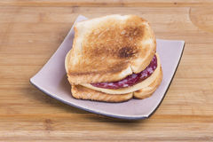 Sandwich from a toast and salami with cheese on pl Stock Image