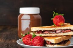 Free Sandwich Toast With Chocolate Paste And Cut Strawberry Royalty Free Stock Image - 188177196