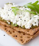 Sandwich of toasted bread. Crispbread with cottage cheese and arugula royalty free stock photography