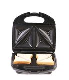 Sandwich toaster with bread slices. Royalty Free Stock Image