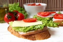 Sandwich with tomato, cheese, bacon and salad Stock Photos