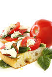Sandwich with tomato, cheese and basil. Stock Photo
