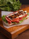 Sandwich with tomato cheese and champignon mushrooms royalty free stock images