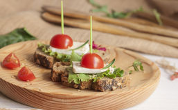 Sandwich with tomato and cheese. Sandwich with tomato cherry  and camembert cheese Stock Images