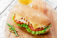 Sandwich with tomato and cheese grilled chicken Royalty Free Stock Photo