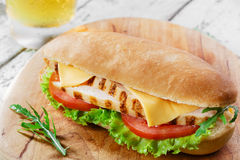 Sandwich with tomato and cheese grilled chicken Stock Photo