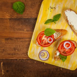 Sandwich with Tomato and Cream Cheese and Basil Royalty Free Stock Photo