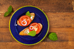 Sandwich with Tomato and Cream Cheese and Basil Royalty Free Stock Image