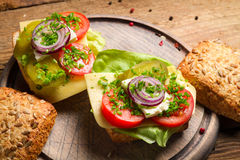 Sandwich with tomato, onion and lettuce Stock Photos
