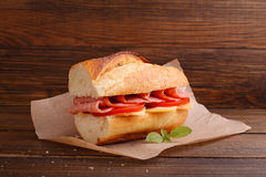 Sandwich with tomato, sausage and cheese Stock Photo