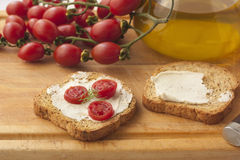 Sandwich with tomato. Toast with tomato on a cutting board Royalty Free Stock Photo