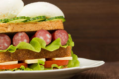 Sandwich with tomatoes, cucumbers, sausages, salad and eggs Royalty Free Stock Images