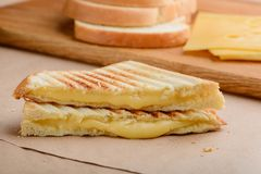 Sandwich triangles. And their ingredients. Crusty grilled toast bread and oozing melted Cheddar cheese stock photos