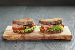 Sandwich with tuna and vegetables on rye bread Stock Photo