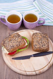 Sandwich with two cups Royalty Free Stock Photos
