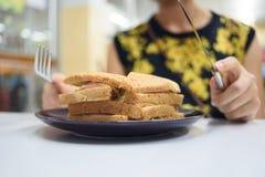 Sandwich und hungriges Stockbild
