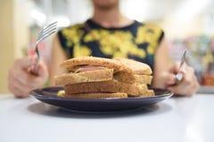 Sandwich und hungriges Lizenzfreie Stockfotografie