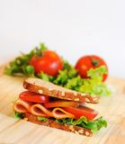 Sandwich with vegetables. On wooden table Stock Image