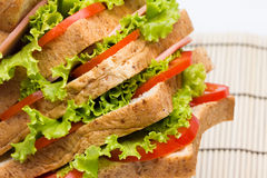 Sandwich with  vegetables and bacon on bamboo close up Stock Photo