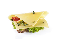 Sandwich with vegetables, cheese and herbs, isolated on backgrou. Sandwich with vegetables, cheese and herbs, isolated on white background Royalty Free Stock Image
