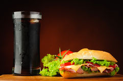 Sandwich, vegetables and cola Royalty Free Stock Photo