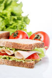 Sandwich and vegetables Stock Image