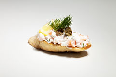 Sandwich with white cheese, dill, olive, lemon on grey backgroun. D Royalty Free Stock Photography