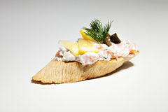 Sandwich with white cheese, dill, olive, lemon on grey backgroun. D Royalty Free Stock Photos