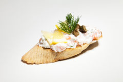 Sandwich with white cheese, dill, olive, lemon on white backgrou. Nd Stock Photography