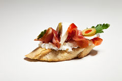 Sandwich with white cheese, parsley, olive, ham and tomato on gr. Ey background Royalty Free Stock Photo
