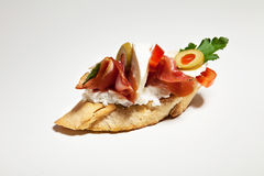 Sandwich with white cheese, parsley, olive, ham and tomato on wh. Ite background Stock Image