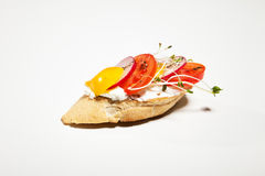 Sandwich with white cheese, pepper, radish and sprouts on the wh. Ite background Royalty Free Stock Photography