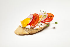 Sandwich with white cheese, pepper, radish and sprouts on the wh. Ite background Royalty Free Stock Photos
