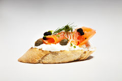 Sandwich with white cheese, salmon, caviar and bean sprouts on g. Rey background Royalty Free Stock Image