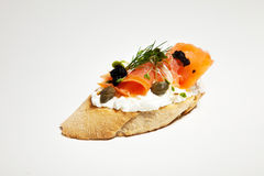 Sandwich with white cheese, salmon, caviar and bean sprouts on w. Hite background Royalty Free Stock Photos