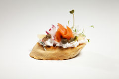 Sandwich with white cheese, salmon, radish and sprouts on the gr. Ey background Stock Photos
