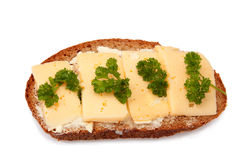 Sandwich of whole bread and cheese and greens Royalty Free Stock Photos