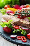 Sandwich with wholegrain bread and prosciutto Royalty Free Stock Image