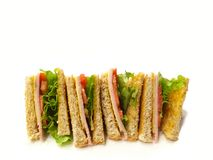Sandwich wholewheat bread on white blackground. Breakfast diet food. Sandwich wholewheat bread with lettuce, ham and yellow cheese on white background with copy Royalty Free Stock Photography