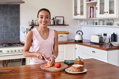 Sandwich woman kitchen Stock Images
